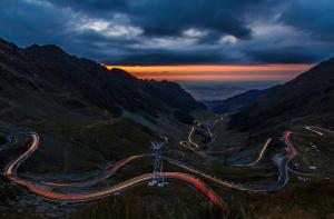Transfagarasan Highway has 90 km. The road climbs to 2,034 metres altitude. The most spectacular route is from the North. It is a winding road, dotted with steep hairpin turns, long S-curves, and sharp descents.