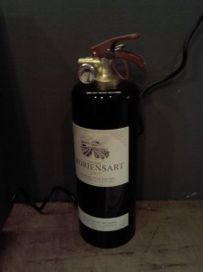 Wine? No! Fire extinguisher.